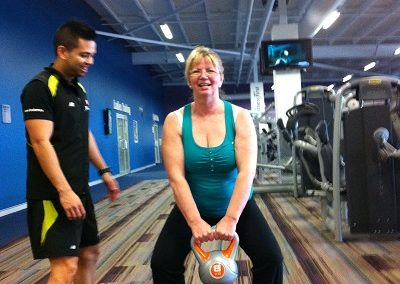 Sharon on the kettlebells